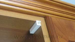 Доводчик верхнего дверцы шкафа